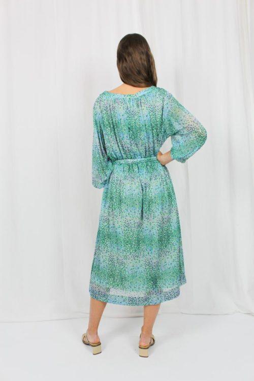grünes Kleid mit Punkten